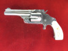 S&W 38 Single Action Revolver with Carved Pearl Grips---$1395.00